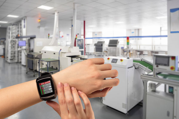 Production line operator wearing a watch with SmartAlert